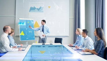 businessman presenting statistics to a group of individuals in a meeting room