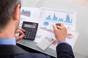 Businessman Calculating Financials