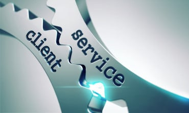 The words service and client feature on metal cogwheels.