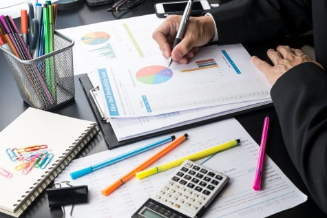 Man analysising business and financial reports