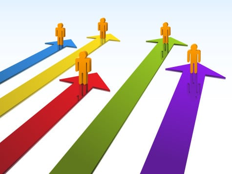 Coloured 3-D arrows with 3-D human figuranes standing of each one