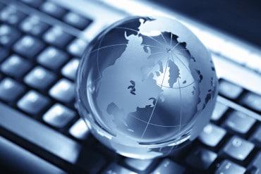 blue globe on computer keyord