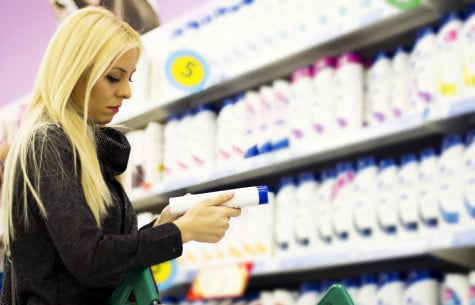 woman shopper looking at a shampoo product