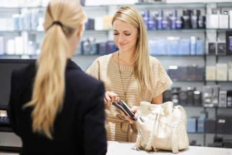 shopper paying for her products at the till