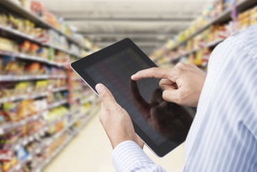 Instore retail audits - man completing survey on a tablet