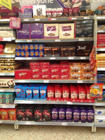 instore shelves filled with chocolate confectionary