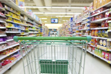 Supermarket Trolley In Aisle